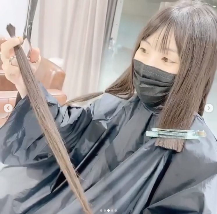 Aoi Koga with a part of her hair.